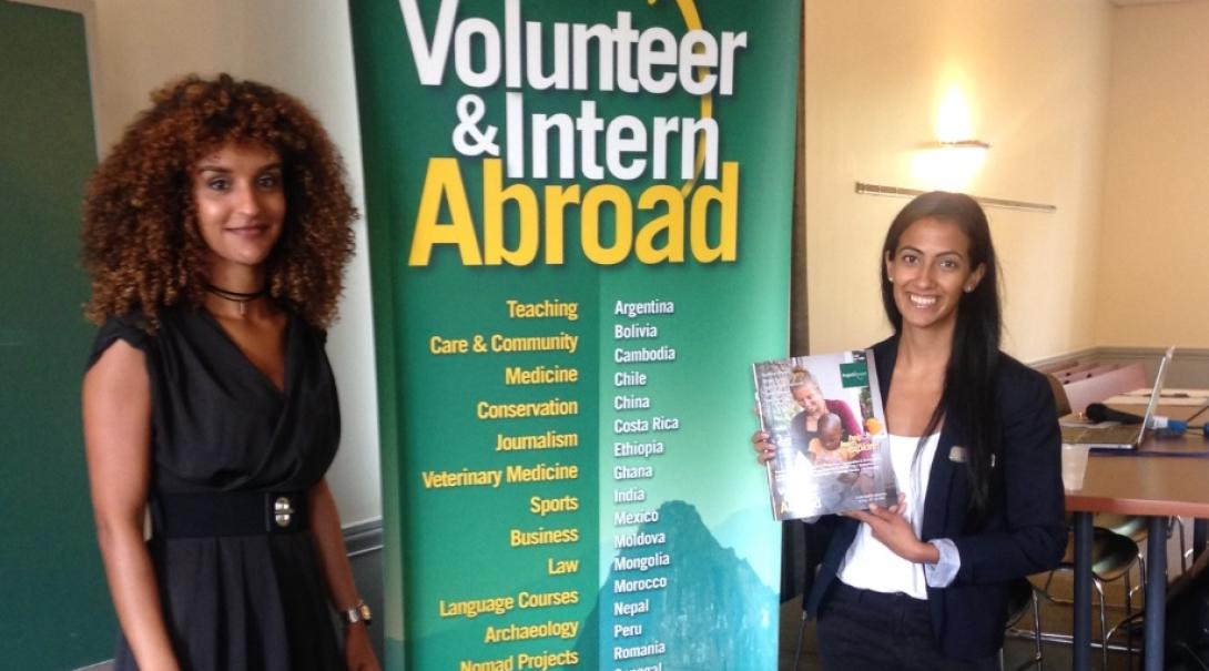 Projects Abroad staff talk to potential volunteers during an information event.